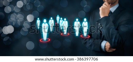 Target audience (marketing) concept. Businessman think about target audience and customers. Wide banner composition with bokeh in background.