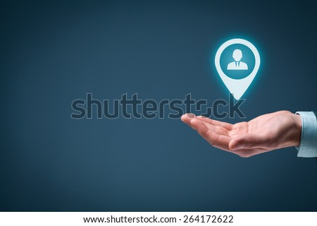 Target customer and human resources (HR) concept. Man hold target customer, employee (or another business person) in hand.  - stock photo
