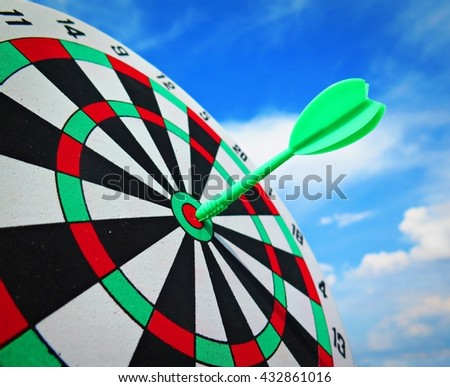 Target dart  on Target with clunds sky backgound - stock photo