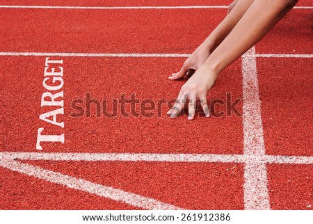 Target - hands on starting line - stock photo