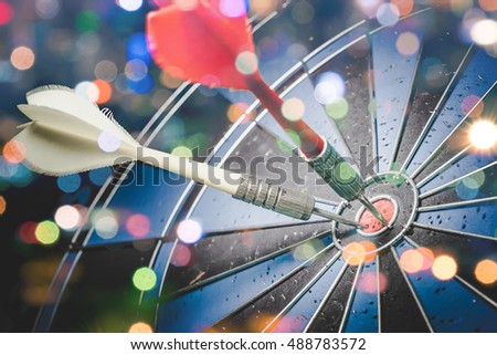 Target marketing or target arrow concept: Bullseye is a target of business. Dart is an opportunity and Dartboard is the target and goal.- Vintage tone with bokeh.