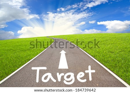 Target Road and cloudy sky - stock photo