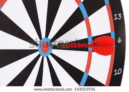 Target with dart close-up - stock photo
