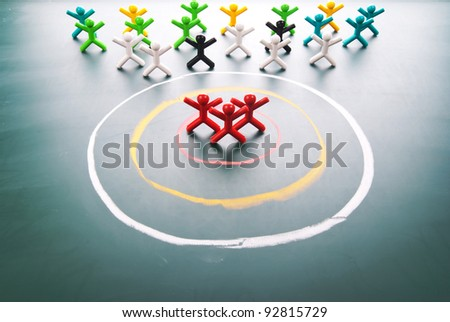 Target your customers. people in the center of circle. - stock photo