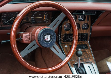 TARGU MURES, ROMANIA 13 May 2016: Interior and steering wheel of a 1978 Chevrolet Corvette Stingray at Vintage Cars Parade Festival 2016 in Targu Mures, Romania - stock photo
