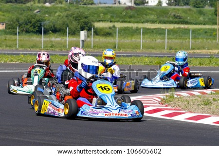 TARGU SECUIESC, ROMANIA - JUNE 16: Leo Borlovan, number 16, competes in National Karting Championship, Round 3, on June 16, 2012 in Bucharest, Romania.