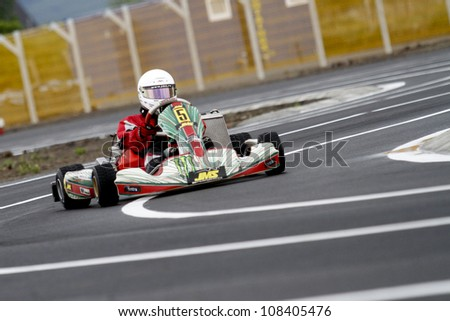 TARGU SECUIESC, ROMANIA - MAY 20: Tomescu Gabriel, number 5, competes in National Karting Championship, Round 2, on May 20, 2012 in Targu Secuiesc, Romania.