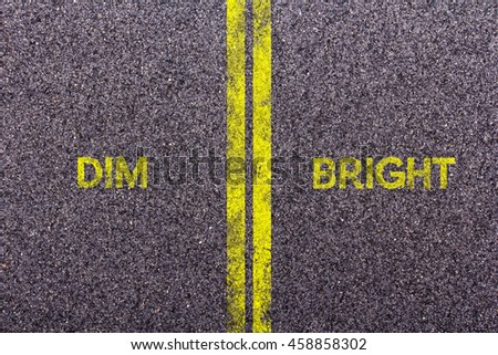 Tarmac background with the words dim and bright