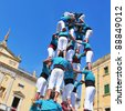 TARRAGONA, SPAIN - SEPTEMBER 23: Castells on September 23, 2011 in Tarragona, Spain. Every September 23, Santa Tecla holiday, those typical catalan human towers are performed in Plaza de la Font - stock photo
