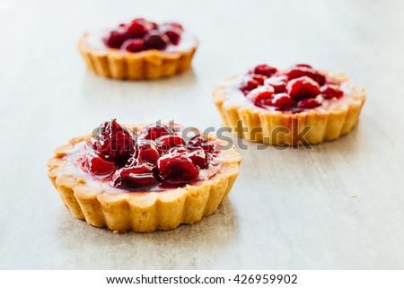 Tart , pie , cake with jellied fresh berries on a grey stone background.  - stock photo