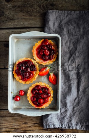 Tart , pie , cake with jellied fresh berries on a wooden background. Copy space - stock photo