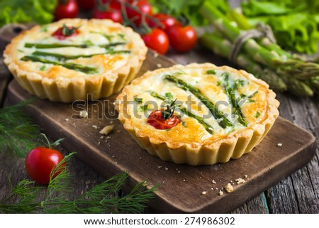 tart with asparagus and cherry tomatoes  on rustic background - stock photo