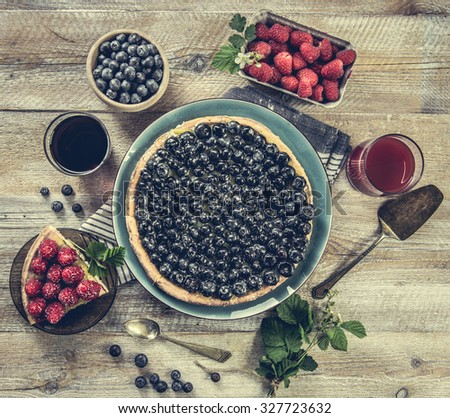 Tart with blueberries and juice on a wooden background. top view