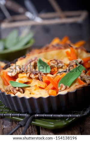 tart with carrots, walnut, cheese and sage, ready to eat