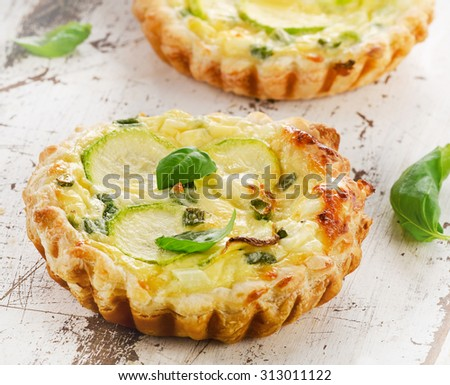 Tart with cheese on wooden table. Selective focus - stock photo