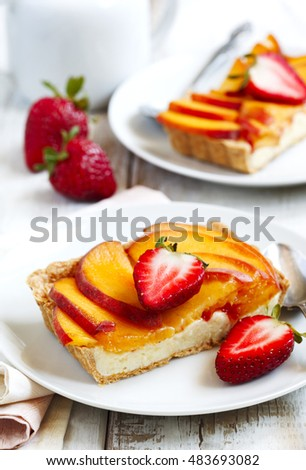 Tart with cream Diplomat, peaches and strawberry