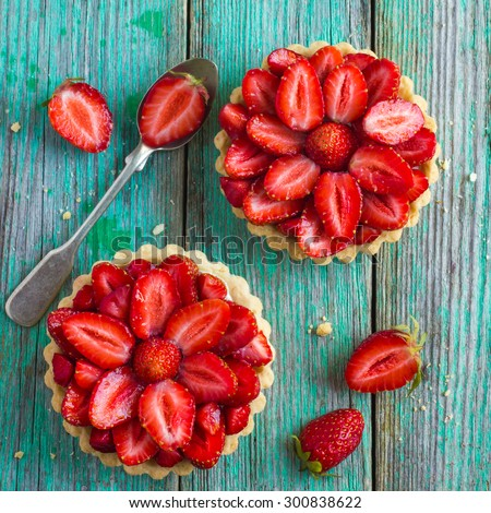 Tart with fresh strawberry on wooden background, top view, square image - stock photo