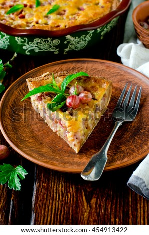 Tart with gooseberries and cream filling - stock photo