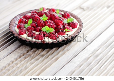 tart with raspberries and chocolate - sweet food - stock photo