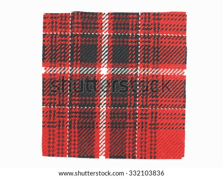 Tartan fabric swatch over white background - stock photo