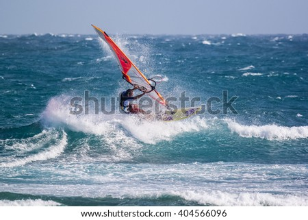 Tartle beach, Mui Ne, Vietnam - December 27, 2015 Windsurfer Igor Yudakov making extreme tricks on the waves