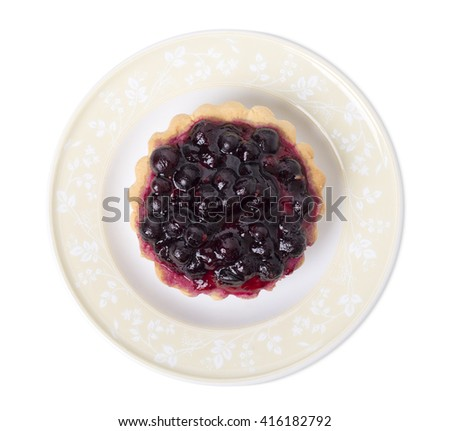 Tartlet with berries and fruit jelly. Isolated on a white background. - stock photo