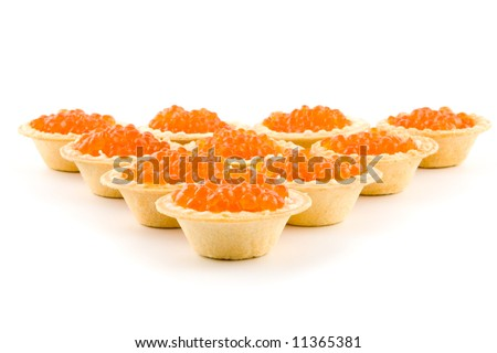 Tartlets with red caviar isolated on a white background