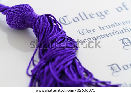 tassel/honor cords resting on top of graduation paperwork