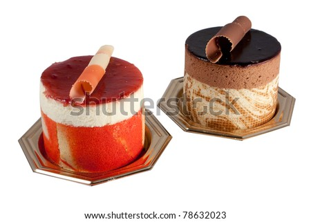 Tasteful Chocolate Pastry mousse and Fruit Pastry made of passion fruit isolated on white background - stock photo