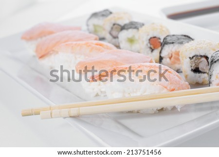 Tasteful frozen sushi with ginger and wasabi