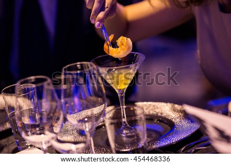 tasting shrimp cocktail on evening of luxury party