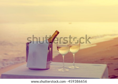 Tasting wine on a summer evening at the beach