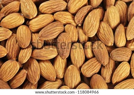 tasty almond nuts closeup background - stock photo