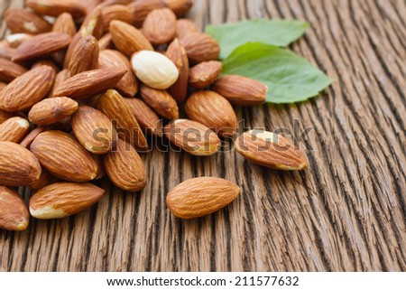 tasty almonds nuts with leaves - stock photo