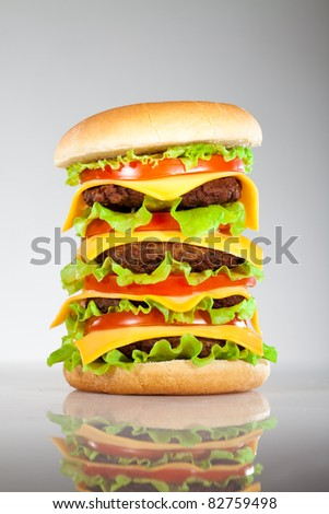 Tasty and appetizing hamburger on a grey background - stock photo