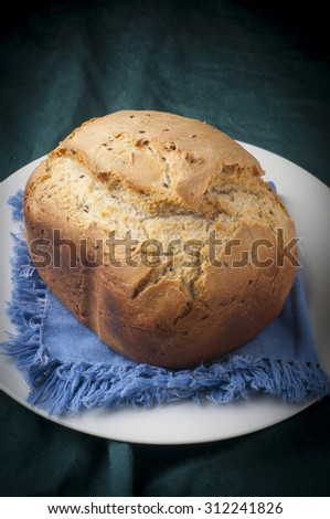 tasty and crispy piece of bread baking at home - stock photo