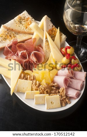 tasty and generous cheese platter to share - stock photo