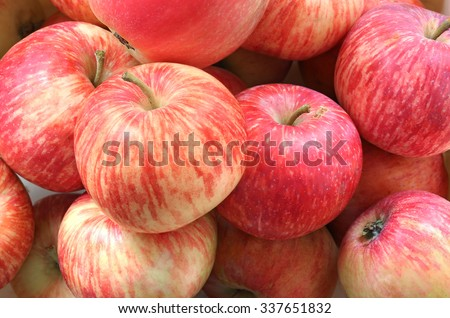 Tasty and juicy apples at a farmers market. Background - stock photo