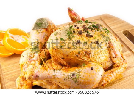 tasty and juicy marinated chicken on a chopping board