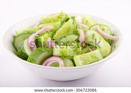 Tasty appetizer  fresh salad on white bowl. - stock photo