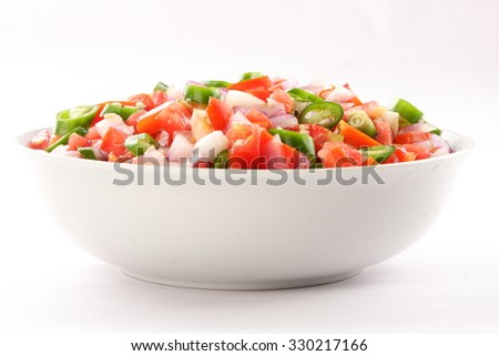 Tasty appetizer meal  with onion and vegetable salsa salad. - stock photo