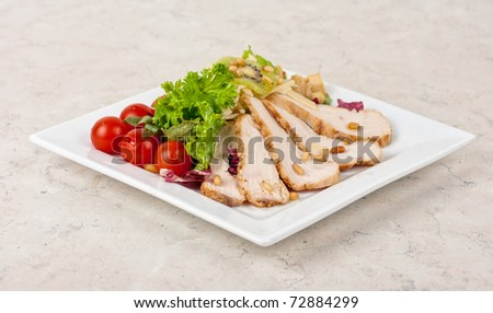Tasty appetizer of meat, cherry tomato, greens and groundnut - stock photo