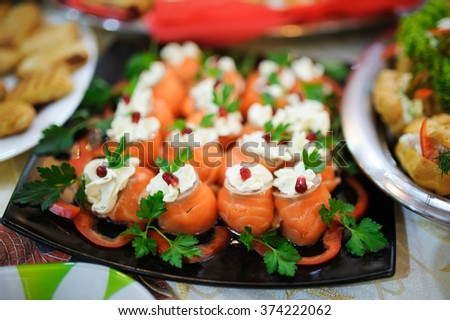 Tasty appetizer.  Plate of red and white fish Salmon fillet - stock photo