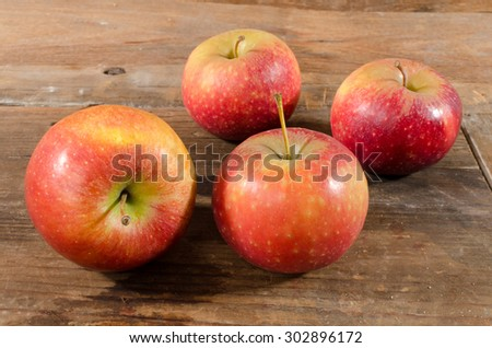 Tasty apples on wooden background - stock photo