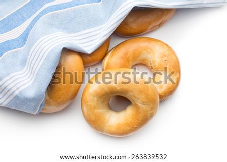 tasty bagels with napkin on white background - stock photo