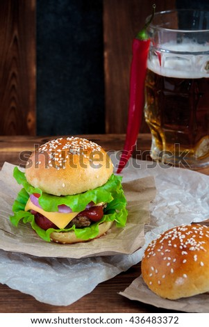 Tasty beef burger with lettuce, ketchup, tomato, onions and cheese ...