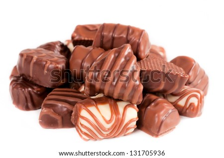 Tasty Belgium sweet chocolate pralines isolated on white - stock photo