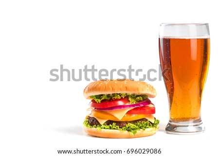 tasty big burger and glass of beer isolated on white background