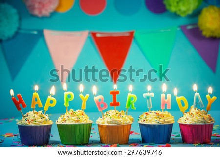 Tasty birthday cupcake with candles - stock photo