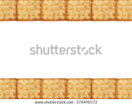 Tasty Biscuits texture closeup details row pattern in top and bottom isolated on white background. Copy space for text at the middle. - stock photo